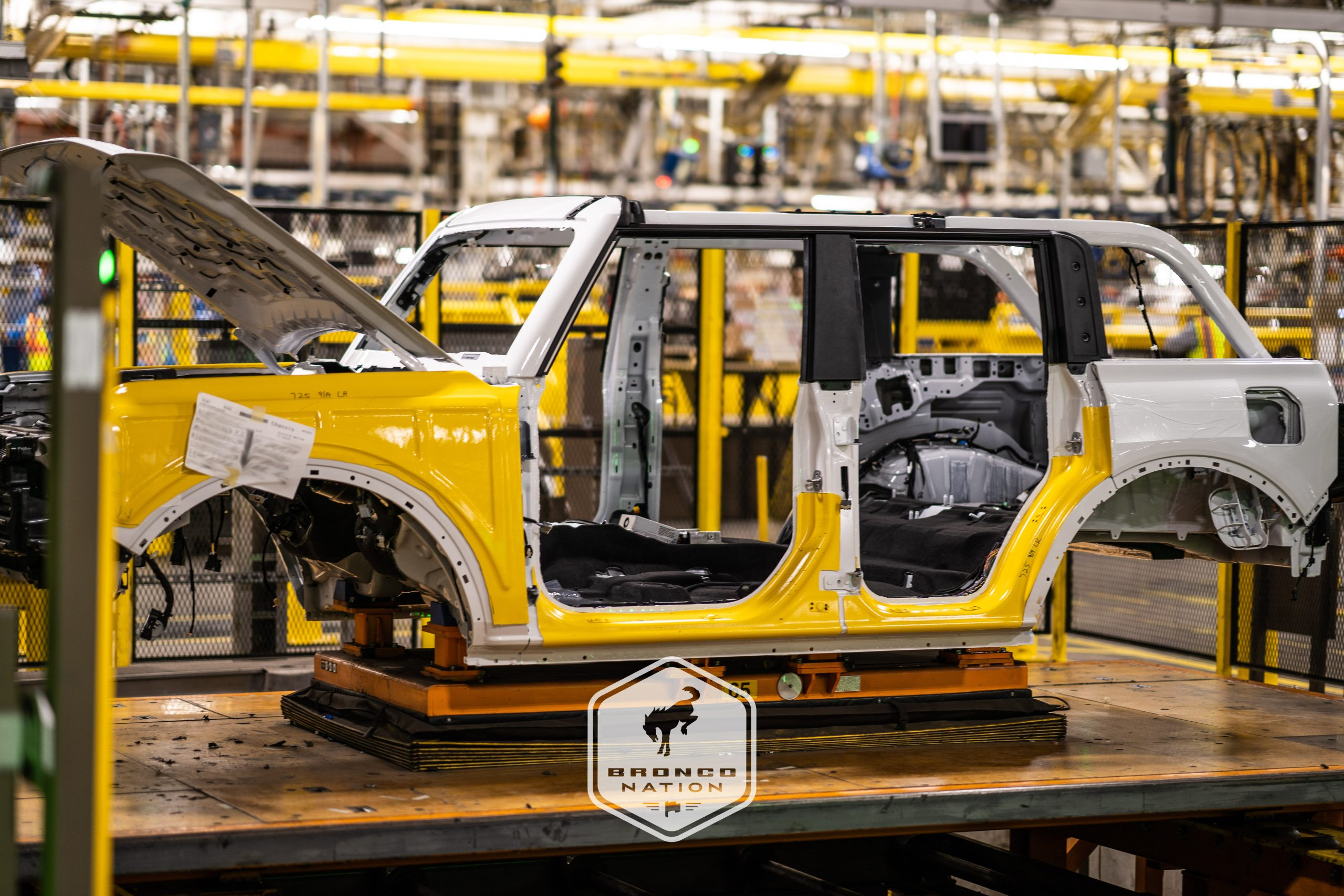 EARLY PRE-PRODUCTION BRONCOS HEAD DOWN ASSEMBLY LINE AT M.A.P.